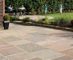 Thinking of laying sandstone paving? Learn how to lay sandstone paving slabs the right way with our quick and easy guides - Marshalls - Creating Better Spaces Patio Slabs, Paved Patio, Flagstone Patio, Sandstone Paving Slabs, Paving Stones, Paving Ideas, Decking Colours Ideas, Paving Design, Garden Paving
