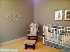 Jenny Lind crib with glider rocker and grey gray walls in baby room