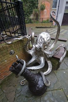 Octopus playing chess, Created by Leigh Dyer at the chess square at Butler's Gap in George Street, Old Town, Hastings, East Sussex.