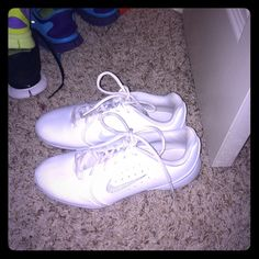 Cheer shoes or Nike shoes Used them two times! I don't use them anymore cause their kinda tight on me!:(! Nike Shoes
