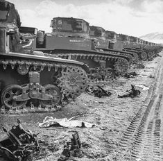 Obsolete M3A1 Light tanks sit in a U.S. Army depot, by Charles E. Steinheimer (1946)
