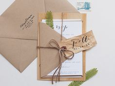 Wedding Invitation Ideas: Modern Rustic Wood Veneer Wedding Invitations with Pressed Fern and Twine by Anelise Salvo Design Co via Oh So Beautiful Paper