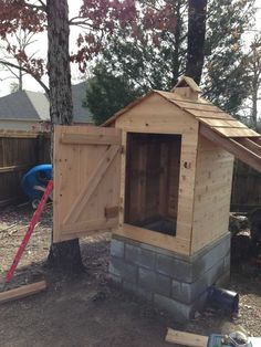 DIY Cedar Smokehouse Construction Plans and Step-by-step instructions.