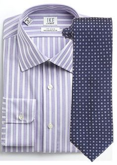 A plain shirt with a striped tie not only gets boring, it's entry-level. Learn to pair patterns and stripes with these 8 examples.