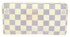 Get the trendiest Clutch of the season! The Louis Vuitton Zippy Wallet [mercari] Damier Azur Zip Around Continental 235521 White Coated Canvas Clutch is a top 10 member favorite on Tradesy. Louis Vuitton Clutch, Ship, Wallet, Ships, Purses, Diy Wallet, Purse