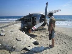 "The seaplane buried in sand in Playa Ventanilla, Mexico  (15°40'24.36""N 96°35'43.59W)"