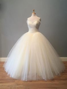 Denise's Poofy Tulle Wedding Dress - Avail & Company, LLCBeautiful poofy tulle flowy fantasy fairy tale wedding dress!  Ruffled top edge with vintage style layered tulle.  Perfect for a pastel, country, winter, spring or fall wedding!