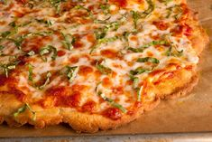 A light brush of olive oil helps this homemade wheat-free pizza dough crisp up…