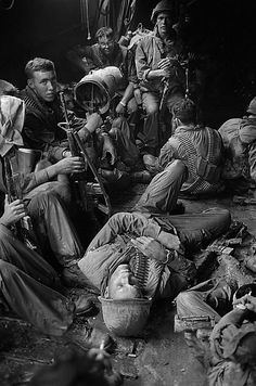 U.S. soldiers of the 9th Infantry Division relax on the long boat trip back to their base camp after a day trudging through the coconut groves of Kien Hoa province in the Mekong Delta during the Vietnam War, 1969. (AP Photo/Henri Huet) ~ Vietnam War