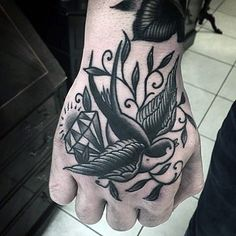 Old school style black ink bird with diamond tattoo on hand ...