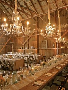 Chandeleirs in a rustic barn make a quirky styling touch