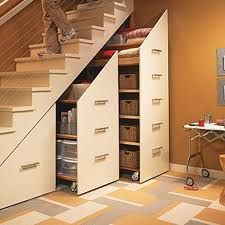 Rolling shelves for recycling under stairs in basement