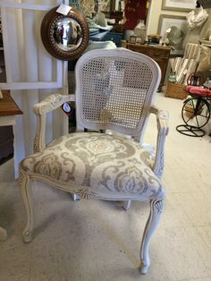 Cane back arm chair, reupholstered and painted with vintage market and design chalk paint, dark wax and matte finishing cream