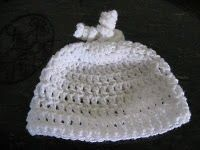 Benjamin got one of these when he was born, made by a nurse at the hospital. I am hoping to get one made for Baby #2 ahead of time, because we're not delivering there this time. This one is sweet. (Free pattern)
