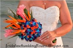 I don't really care for the pink flowers, but I love the Bird of Paradise and blue orchids (Dendrobiums) in this bouquet!