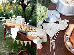 pretty outdoor buffet display on wood table with burlap flag banner and paper book page hearts and pinwheel decor via Valdirose