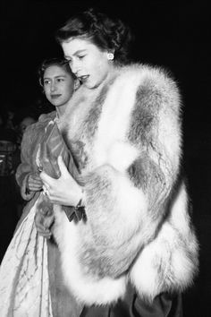 Princess Elizabeth with Princess Margaret in the background.