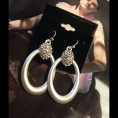 Gorgeous Rhinestone Hoops This beautiful earrings feature encrusted rhinestone design and measure 2 inches long. Perfect for special events. (This closet does not trade or use PayPal) Jewelry Earrings