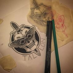 Working on patch and pin designs @thetallonco www.thetallon.com #skull #dagger #moth #tattoo