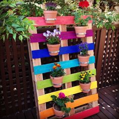 Rainbow+Pallet+Flower+Garden+Planter+|+Clever+DIY+Wood+Pallet Projects+You+Can+Do+Now