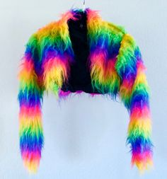 • GREAT Condition! •  Beautiful and soft rainbow fur jacket, only worn twice! Small/Medium: Length: 12.5  Sleeves: 23  Shoulder to Shoulder: 15.5 Care: • Machine or hand wash • Do not steam/iron/bleach • Brush or comb to restore pile  Pile: • 50% Acrylic Fibre • 50% Modacrylic Fibre Backing: • 32% Polyester • 26% Acrylic • 26% Modacrylic • 16% Acrylic Resin