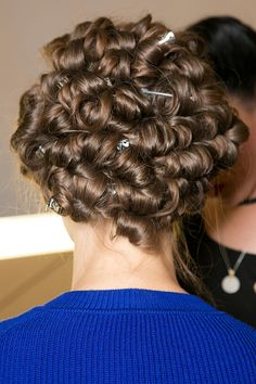 Marc by Marc Jacobs: To get the fluffy curls, Redken's Guido curled the whole head with a one-inch curling iron and set the look with tiny barrel curls. Later, the hair was brushed out to reveal a mountain of waves.
