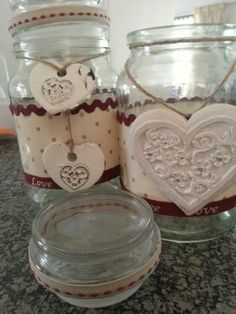 """Old coffee jars become """"hurricane"""" style candle holders"""