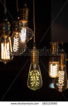 Retro style lighting bulb decor - stock photo