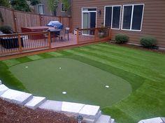Trek deck, turf grass, fire pit and golf putting green - love our backyard