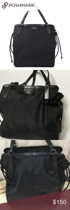 """Authentic Burberry 'Buckleigh' black nylon tote Authentic Burberry 'Buckleigh' black nylon packable tote handbag - Black leather accents, trim & bottom - Flat leather top handles - Top zipper closure with adjustable leather drawstring - Interior is lined in classic nova check textile fabric w/ side zipper pocket - 16"""" tall + 8"""" handle drop, 14"""" wide + expands 3""""   - Purchased at a Burberry store, original tag included - All zippers work - See last photo for flaws -- wear at top of handles…"""