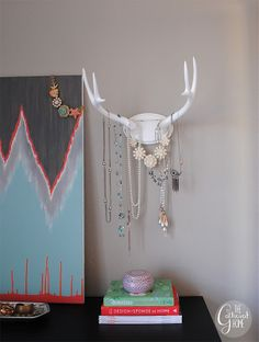 DIY Faux Deer Antlers Jewelry Holder. This blogger used just a bit of paint and a thrifted treasure to make the chicest jewelry holder ever. Via www.thegatheredhome.com