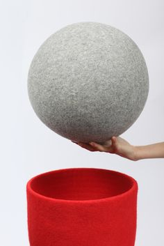 "Soft Ball. Design by Lorenzo Damiani for Tumar Art Group. Foam covered with felt 2.5 mm thick. No-stitch technology. Cover for the container, a salutary ""anti-stress"" toy, and an accent in the interior. Felt: semi-fine wool. Colour: light grey."
