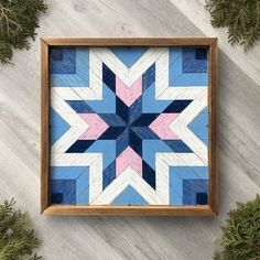 Featuring light pink and country blue hues, this handmade star barn quilt exudes rustic charm. Handcrafted with premium cedar, each wood cutout of the mosaic design is hand painted and lightly distressed to give it a vintage time worn feel. Barn quilts are an easy way to add color, texture, and design to any wall space in your home. They can be displayed in your entryway, living room, bedroom, or home office. Visit Crow Bar D'signs to find the perfect wood wall art piece for your home. Barn Quilt Designs, Quilting Designs, Wood Wall Decor, Wood Wall Art, Rustic Style, Rustic Charm, Wooden Barn, Star Quilt Blocks, Handmade Signs