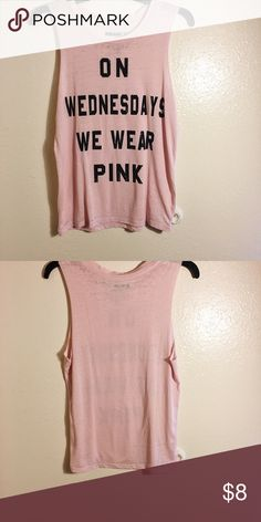 "On Wednesdays We Wear Pink graphic muscle tee Th perfect shirt inspired by the popular movie Mean Girls!  The shirt is a muscle tee style with the words "" On Wednesdays We Wear Pink"" inspired by the movie. Only worn once. 55% cotton, 45% polyester. Fits true to size. Tops Muscle Tees"