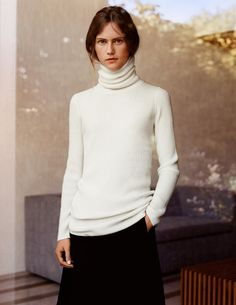 Cashmere rib turtleneck sweater, $129.90; cashmere-blended wrap skirt, $89.90.