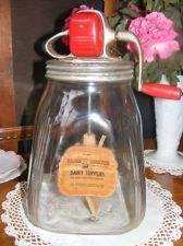 VINTAGE GLASS BUTTER CHURN WITH PAPER LABEL. Adore Vintage at www.adorepurses.com