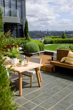Roof garden, bright green with warm wooden furniture | adamchristopherdesign.co.uk