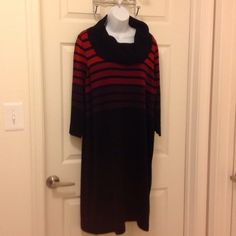 New Listing! Multi color sweater dress Multicolored sweater dress with colors of burgundy, rust, purple, and black. Great dress to wear with heels or boots. Has a cowl neckline. Material is 100% acrylic. Length is approx 39 1/2 inches from shoulder to bottom hem. Dresses