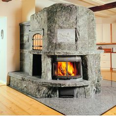 Tulikivi Masonry Heaters are incredible soapstone fireplaces that offer a range of benefits from better heat efficiency to truly unique appearance and more. Concrete Fireplace, Stove Fireplace, Fireplace Remodel, Fireplace Wall, Corner Wood Stove, Fireplace Gallery, Soapstone, Dream House Plans, Cabin Homes