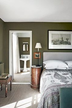 Green country bedroom in Bedroom Decoration Ideas. The main bedroom with a view to the bathroom. Both have been painted a rich olive green.