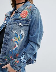 Denim jacket with embroidery. Love this.  Click to shop.