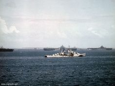 A closer view of Flint CL-97. The bow of Enterprise is at left, Bunker Hill at center and Essex CV-9 at right.