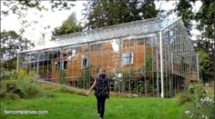 Couple Builds Greenhouse Around Home to Grow Food and Keep Warm the ultimate greenhouse