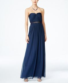 Adrianna Papell's stunning strapless gown with notched neckline radiates modern…