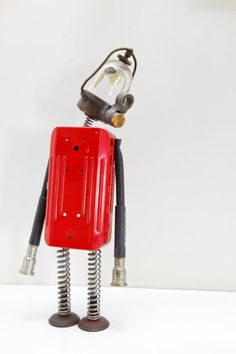 Space Junk The Crew a serie of sculptures made from junk and vintage parts to resemble retro futuristic robots.