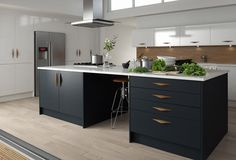 K Kitchens Ludlow kitchen for Wren Living contrast with the island's dark cabinetry ...