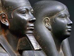 """Detail of a statue of King MenkauRa and a Queen (probably Queen Kamerernebty II) from the """"Valley Temple"""" next to His Pyramid at Giza."""