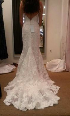 Casablanca 1975 wedding dress currently for sale at 16% off retail.