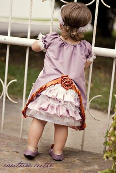 """I just love this adorable bustle dress, or """"the mullet dress"""" as the author calls it, haha. Started with a basic peasant dress pattern. #sewing #baby #clothes"""
