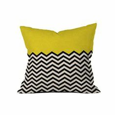Woven pillow with a color-blocked chevron motif. Made in the USA. Product: PillowConstruction Material: Woven polyester coverColor: Yellow, black and white    Features: Designed by Bianca Green for DENY DesignsZippered closureInsert includedMade in the USAChevron motif    Cleaning and Care: Spot treat with mild detergent